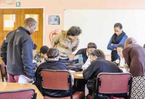 MacDonald & the AIMS tutors assisting the learners